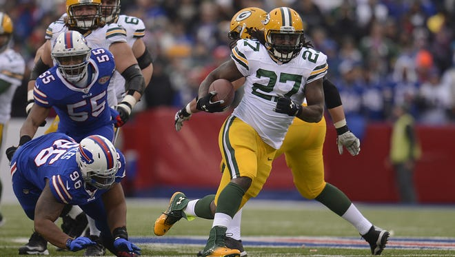 Green Bay Packers running back Eddie Lacy (27) breaks away for a long run in the first quarter during Sunday's game against the Buffalo Bills at Ralph Wilson Stadium in Orchard Park, N.Y.