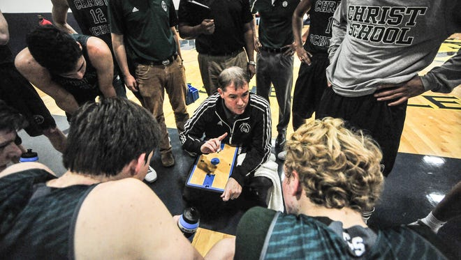 Christ School coach Scott Willard talks to his basketball team during Tuesday's game at Asheville Christian Academy.
