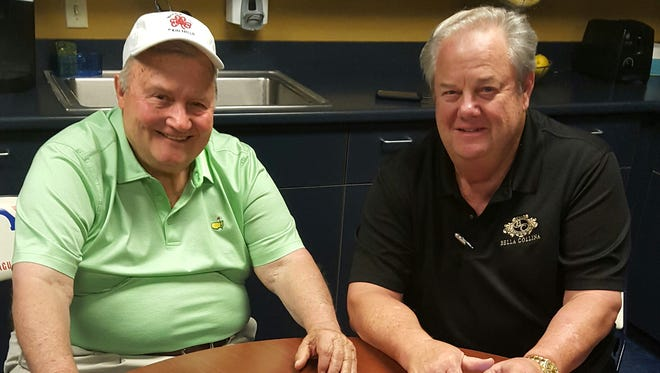 Bruce Froemming (left) and Joe West visit in the umpires' room at Miller Park.