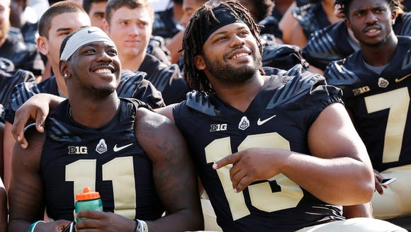 Antoine Miles, left, and Gelen Robinson pose for a