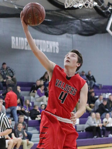 Valders' Jared Ahl (4) aims for the basket against