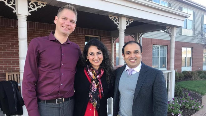 Organizers of the Diwali celebration Troy Gold Goldschmidt, Swati Sisosia Biswas and Nick Patel.