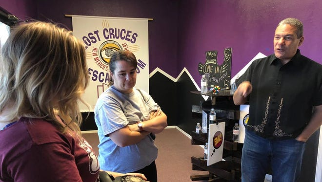 Lost Cruces Escape Room Managing Director Griffin Allen, right, speaks with Jennifer Byers, left, and Mary Morgan, middle, during their experience solving Ariana's Wedding.