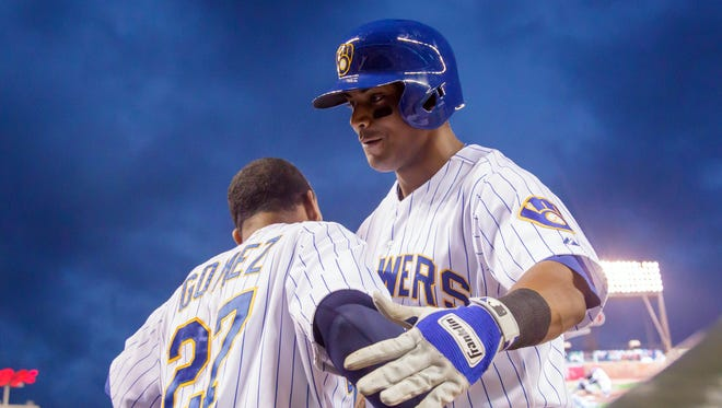 Khris Davis, right, and Carlos Gomez have been key members of baseball's most surprising team.