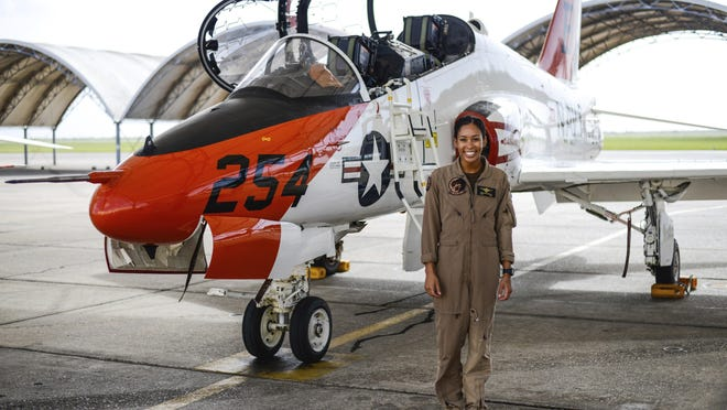 KINGSVILLE, Texas - Student Naval Aviator Lt. j.g. Madeline Swegle, assigned to the Redhawks of Training Squadron (VT) 21 at Naval Air Station Kingsville, Texas, stands by a T-45C Goshawk training aircraft following her final flight to complete the undergraduate Tactical Air (Strike) pilot training syllabus July 7. Swegle is the Navy's first known Black female strike aviator and will receive her Wings of Gold during a ceremony July 31.