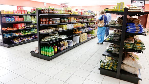 Shoppers at Bismillah Groceries and Kitchen on Congess