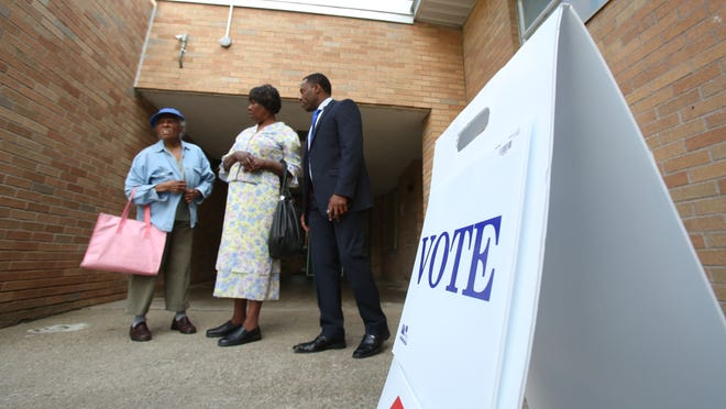 Marie Dacilas, left, Freda Francois and Eudson Francois at New Hempstead Elementary for the annual school district budget and Board of Education election in the East Ramapo school district May 19, 2015. Eudson votes at another polling place, but drove his mother here to vote.