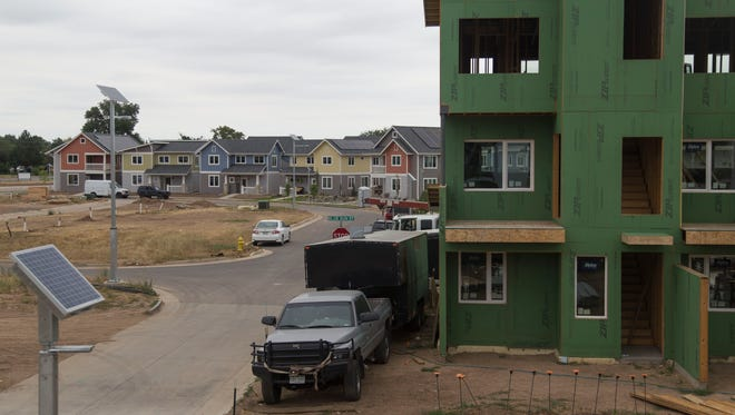 Construction continues at the Revive housing development, which uses solar and geothermal power.  Fort Collins' new Building Energy Scoring and Disclosure Program allows apartment-seekers, house-hunters and business owners to see how different properties would impact their utility bills.
