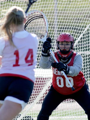 Bernards goalie Charlotte Grimm takes shots in practice on Tuesday.