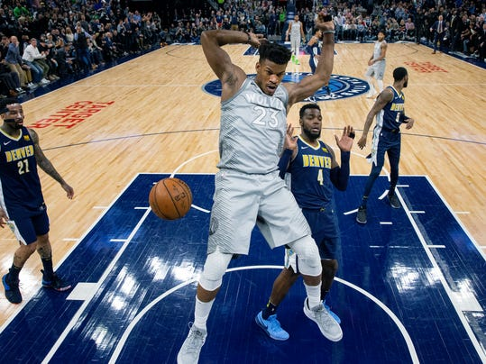Minnesota Timberwolves Jimmy Butler (23) dunks against the Denver Nuggets during the first half of an NBA basketball game Wednesday, April 11, 2018, in Minneapolis. (Carlos Gonzalez/Star Tribune via AP)