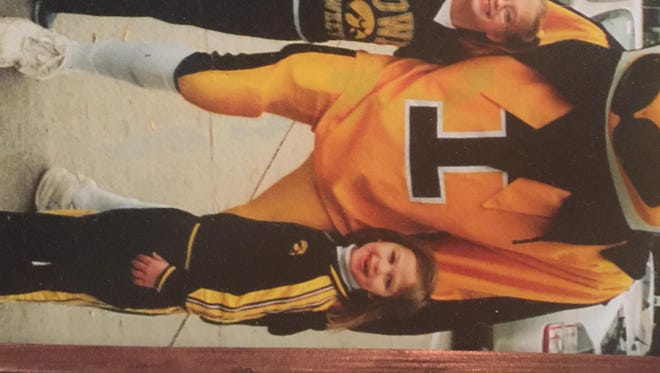 Matthew Meyer (left), Makenzie Meyer (middle) and Megan Meyer (right) pose with Herky the Hawk as children.