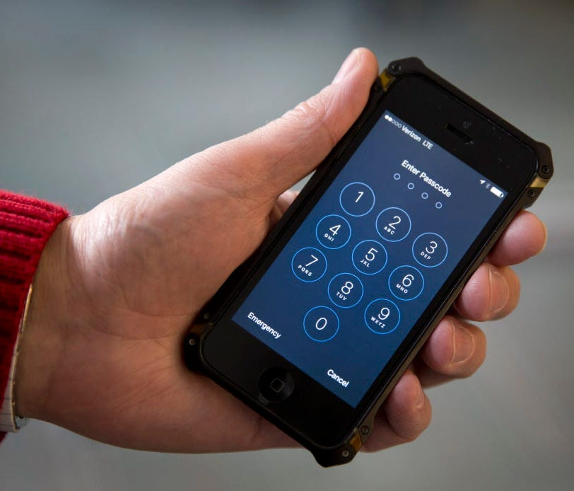 An iPhone is seen Feb. 16, 2017, in Washington. The government inspected a record number of international travelers' electronic devices in the last budget year. U.S. Customs and Border Protection announced Friday that it inspected 30,200 phones and o