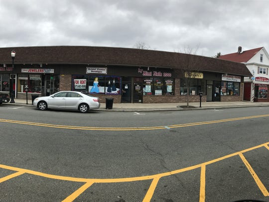 A developer has proposed demolishing the two buildings pictured here on Wanaque Avenue to make room for a new five-story residential luxury apartment building with retail space at the street level.