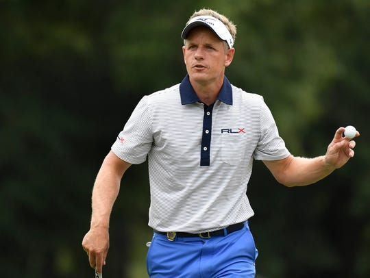 Luke Donald reacts to his putt on the 11th green during the first round of the 2017 PGA Championship at Quail Hollow Club.