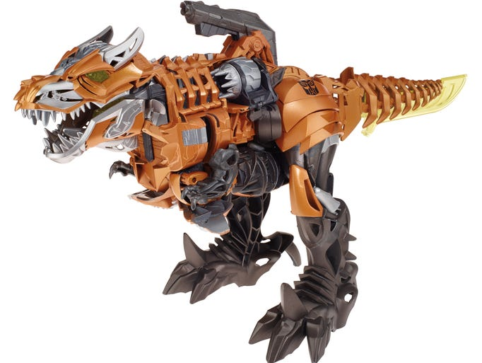 "Dinobots are back on the big screen in ""Transformers: Age of Extinction"" (out June 27) and in the movie toys. Here, a look at the Robots in Disguise line with Dinobot warrior Grimlock."