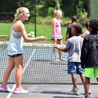 Sisters share their passion for tennis with younger students