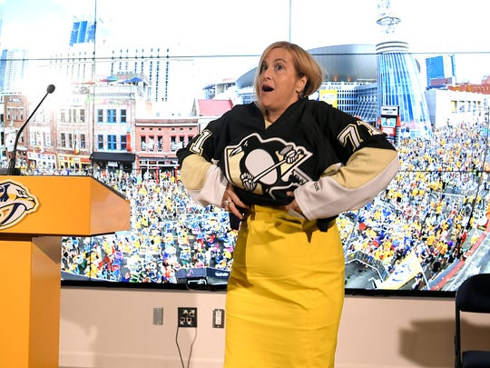 Nashville Mayor Megan Barry reluctantly puts on a Penguins jersey Thursday, June 15, 2017 as part of a wager with the mayor of Pittsburgh over the Stanley Cup Final.
