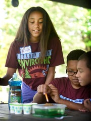Aaliyah Ferrer, a fifth grade student from Southeast Elementary School in Lebanon, works with Stephon Prester, also of Southeast, and Anthony Malone of Northwest Elementary School, during the 23rd annual Elementary School Envirothon at Coleman Memorial Park in Lebanon Thursday morning, May 12.  Palmyra's Pine Street Black team was named the winner of the envirothon, which is sponsored by the Lebanon County Conservation District. Team members are Maggie Copeland, Devon Grant, William Wolford, Julia Klucinec and Tyler Mahaffey.