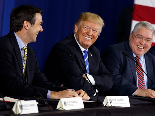 President Donald Trump smiles during a roundtable discussion