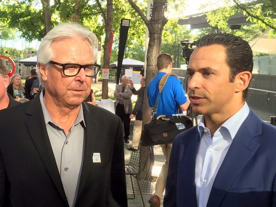 Former Penske Racing driver Rick Mears (left) and current IndyCar team driver Helio Castroneves during the outdoor reception for Roger Penske's  Cameron R. Argetsinger Award cerimoney at the the Corning Museum of Glass.