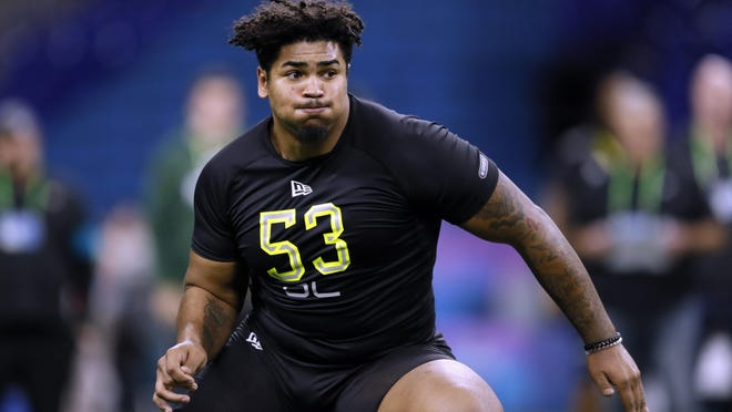 Iowa offensive lineman Tristan Wirfs runs a drill Feb. 28 at the NFL football scouting combine in Indianapolis. Wirfs was selected by the Tampa Bay Buccaneers in the first round of the NFL draft.