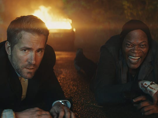 """Ryan Reynolds plays a bodyguard recruited to protect a hitman ((Samuel L. Jackson) who is testifying against a tyrant in """"The Hitman's Bodyguard."""""""