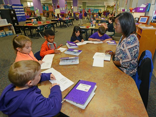 Students work on reading at NSU Elementary Lab, a school
