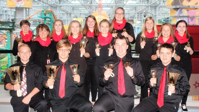 The Spencer High School Handbell Ensemble participated in The Big Ring on Nov. 19 at the Mall of America to help raise awareness of The Salvation Army Red Kettle Campaign and set a new Guinness World Record. Pictured are Will Johnson, front row from left, Zach Dunbar, Elijah Schuh, Damian Albert; Diane Veale, middle row from left, Sydney Johnson, Cheyenne Thompson, Aryiah Schuh; Jessica Becker, back row from left, Courtney Buss, Alyssa Stoiber, Kassie Morzewski, Lexi Baehr and Jeaurdyn Czaikowski.