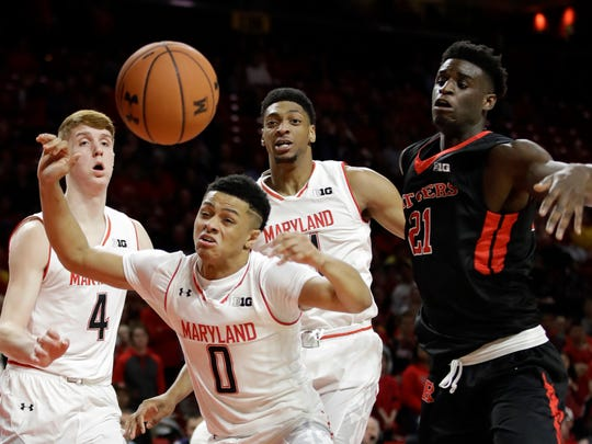 Maryland's Kevin Huerter, Anthony Cowan and Justin Jackson, from left, look for a rebound in front of Rutgers forward Candido Sa.