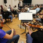 Once bankrupt, orchestra strikes new chords