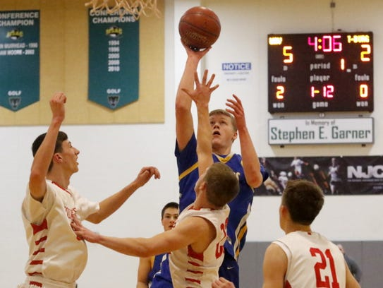Trumansburg's Austin Grunder puts up a shot as three