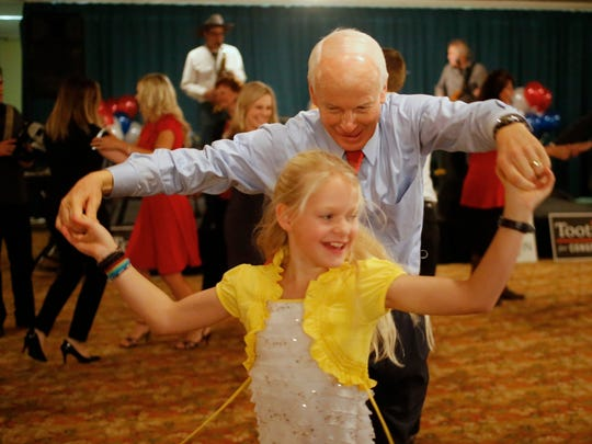 Oregon Republican gubernatorial candidate Rep. Dennis Richardson dances with his granddaughter, India Whoolery, 10, while waiting for results to come in, Tuesday, Nov. 4, 2014, at the Monarch  Hotel and Convention Center, in Portland, Ore. (AP Photo/Timothy J. Gonzalez)