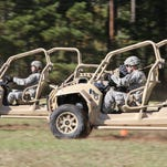 Paratroopers assigned to the 1st Battalion, 325th Airborne Infantry Regiment, 2nd Brigade Combat Team, 82nd Airborne Division, drive the brigade's new Light Tactical All Terrain Vehicle on Oct. 29 on Fort Bragg, N.C.