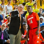 Syracuse head coach Jim Boeheim, left, gives instruction to Syracuse guard Kaleb Joseph (14) in the second half of an NCAA college basketball game against Michigan at Crisler Center in Ann Arbor, Mich., Tuesday, Dec. 2, 2014. Michigan won 68-65. (AP Photo/Tony Ding)
