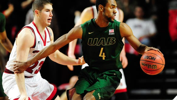 UAB guard Robert Brown (4) dribbles the ball as Western