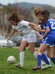 Grace Brethren's Allie Spaccarelli emerges from the Nordhoff pack with the ball during Thursday's playoff game at Grace Brethren.