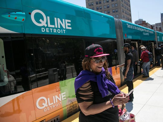 Anjela Thomas-Soulet of Detroit is all smiles after arriving back from her first ride during the grand opening festivities for the QLINE, the city's newest transit system in downtown Detroit on Friday May 12, 2017.
