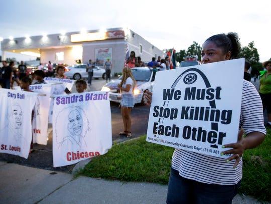 Protesters prepare to march along West Florissant Avenue,