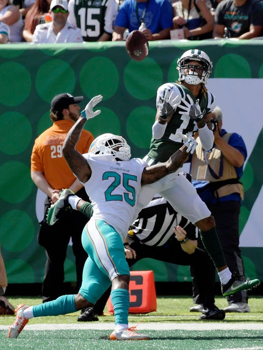 c573546b759 Miami Dolphins cornerback Xavien Howard (25) and New York Jets wide  receiver Robby Anderson