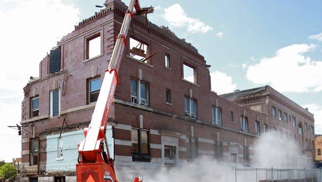 The demolition of the historic Hotel Menasha on July 24, 2014, in Menasha, Wis.