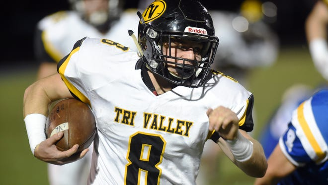 Caleb Craig runs for a 51-yard touchdown during the second quarter of Tri-Valley's 30-7 win against Maysville on Friday night at the Maysville Athletic Complex. Craig ran for 132 yards on 15 carries to help the Scotties secure a playoff spot.