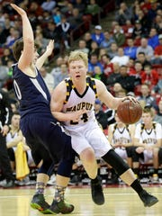 Waupun's Owen Theune drives to the basket last year during the WIAA Division 3 state championship at the Kohl Center in Madison.