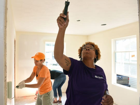 Homeowner Whitnee Holloway works alongside wives of