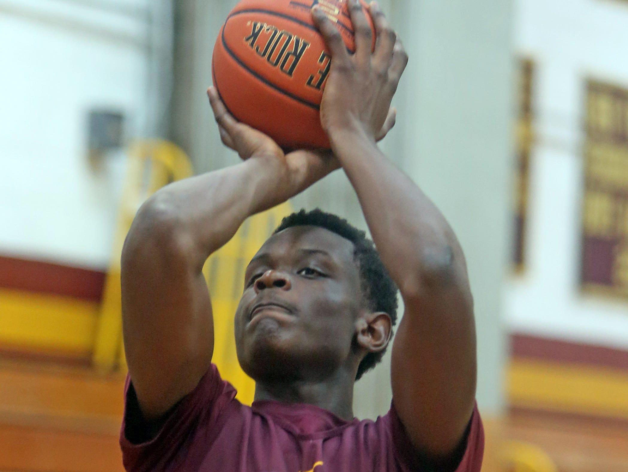 Mount Vernon High School basketball player Greg Calixte shoots during practice Nov. 25, 2015.