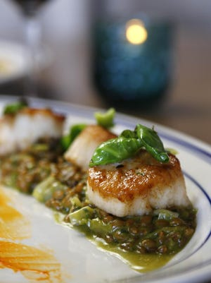 Pan seared scallops with Farro from The Arcadia Yacht Club, Monday, June 1, 2015 in Phoenix.