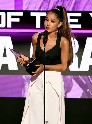 Ariana Grande accepts the Artist of the Year award onstage during the 2016 American Music Awards at Microsoft Theater on Nov. 20 in Los Angeles.