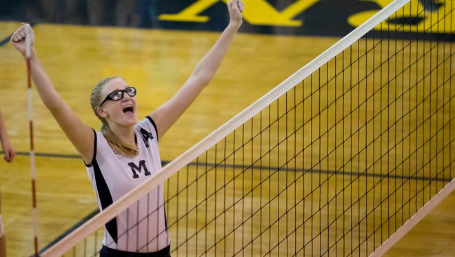 Marysville junior Payton Husson celebrates scoring a point during a volleyball game Tuesday, September 29, 2015 at Port Huron Northern High School.