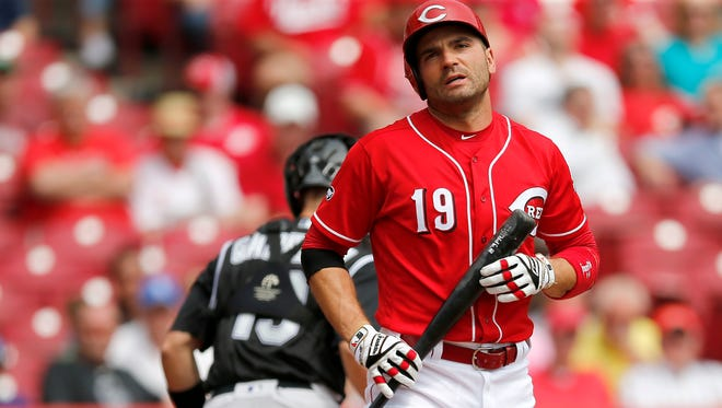 Reds first baseman Joey Votto reacts after striking out in the first inning of Wednesday's win over the Rockies.