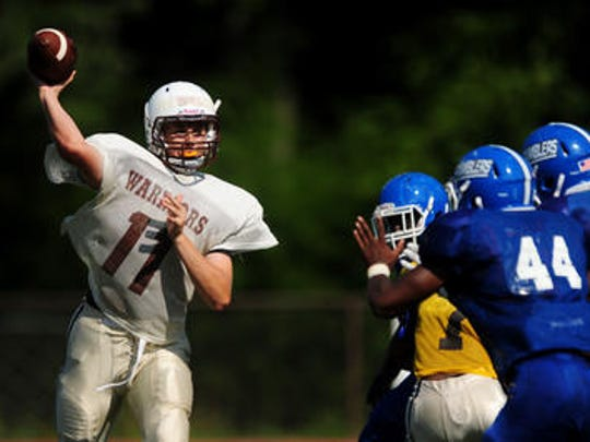 Watchung Hills quarterback Mark Ball led his team over Hillsborough on Friday.