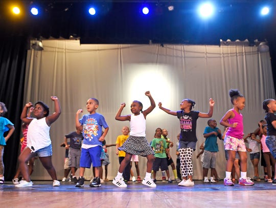 Horizon summer camp students learn to dance together